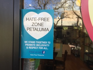 HATE-FREE ZONE decal posted on store front window in Petaluma